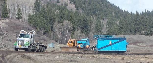 A picture containing outdoor, ground, tree, truck  Description automatically generated
